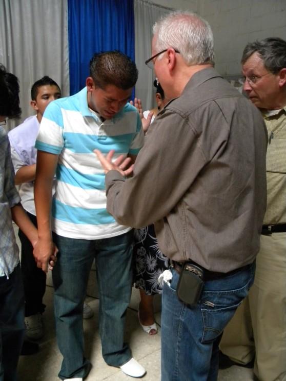 Kevin praying in Costa Rica.